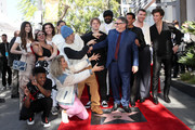 Sir Lucian Grainge (C) is accompanied by guests including (L-R) Tori Kelly, Hailee Steinfeld, Justin Bieber, Lionel Ritchie, Sam Smith and Shawn Mendes as he is honored with a star on the Hollywood Walk of Fame on January 23, 2020 in Hollywood, California.