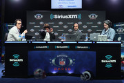 (L-R) Brady Quinn, Deion Sanders, Bruce Gradkowski and Bruce Murray attend SiriusXM at Super Bowl LIII Radio Row on January 31, 2019 in Atlanta, Georgia.