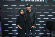 Kat Graham and Michael Yo attend SiriusXM at Super Bowl LIII Radio Row on January 31, 2019 in Atlanta, Georgia.