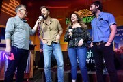 "(L-R) SiriusXM Host Buzz Brainard and Recording Artists Charles Kelley, Hillary Scott, and Dave Haywood of Lady Antebellum speak on stage to the crowd during SiriusXM Hosts Draft Week Party At Margaritaville Featuring The Highway's ""Music Row Happy Hour"" And SiriusXM NFL Radio's ""Movin' The Chains"" on April 24, 2019 in Nashville, Tennessee."