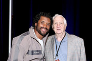 NFL quarterback Russell Wilson of the Seattle Seahawks and SiriusXM host Gil Brandt attend day 2 of SiriusXM at Super Bowl LIV on January 30, 2020 in Miami, Florida.