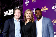 (L-R) SiriusXM hosts Joel Osteen, Victoria Osteen and former NFL player Brian Westbrook take photos during day 3 of SiriusXM at Super Bowl LIV on January 31, 2020 in Miami, Florida.