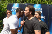 """Axwell and Ingrosso and Reggie Bush (C) attend SiriusXM""""s """"UMF Radio"""" Broadcast Live From The SiriusXM Music Lounge at W Hotel on March 26, 2015 in Miami, Florida."""