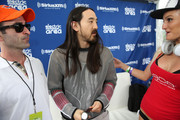 """Danny Valentino (L) and Steve Aoki (R) attend SiriusXM's """"UMF Radio"""" at the SiriusXM Music Lounge at W South Beach on March 27, 2014 in Miami Beach, Florida."""