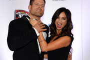 Co-hosts Brian Stann (L) and Nicole Dabeau joke around as they arrive at the sixth annual Fighters Only World Mixed Martial Arts Awards at The Palazzo Las Vegas on February 7, 2014 in Las Vegas, Nevada.