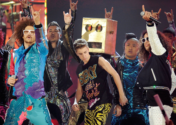 Sky Blu Singer Justin Bieber C performs onstage with Redfoo L and