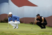 Thomas Aiken of South Africa (left) and Haydn Porteous of South Africa (right) prepare their putts on the 18th green during Day Three of Sky Sports British Masters at Walton Heath Golf Club on October 13, 2018 in Tadworth, England.