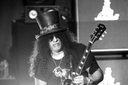 Image has been converted to black and white) Slash performs at the Ryman Auditorium on August 06, 2019 in Nashville, Tennessee.