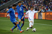 Fabio Quagliarella and Gianluca Zambrotta challenge Peter Pekarik of Slovakia during the 2010 FIFA World Cup South Africa Group F match between Slovakia and Italy at Ellis Park Stadium on June 24, 2010 in Johannesburg, South Africa.