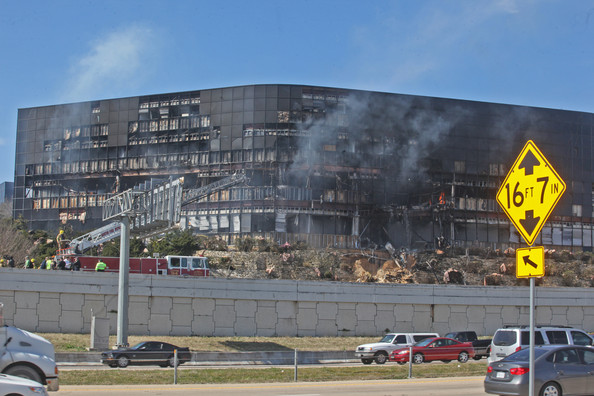 Smoke billows from a building that houses IRS offices after a small plane crashed into it February 18, 2010 in Austin, Texas. According to reports, the pilot, identified as Joseph A. Stack III, was killed in the crash.