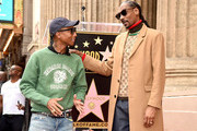Snoop Dogg, with Pharrell Williams (L) is honored with a star on The Hollywood Walk Of Fame on Hollywood Boulevard on November 19, 2018 in Los Angeles, California.