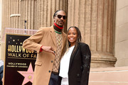 Snoop Dogg, with his wife Shante Broadus, is honored with a star on The Hollywood Walk Of Fame on Hollywood Boulevard on November 19, 2018 in Los Angeles, California.