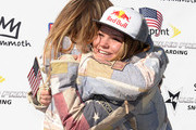 Ty Walker receives a hug from Jamie Anderson in celebration of their spots on the The United States Olympic team for Snowboarding Slopestyle at the 2014 Sprint U.S. Snowboarding Grand Prix at Mammoth Mountain Resort on January 19, 2014 in Mammoth, California.