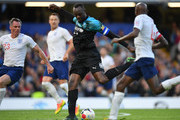 Usain Bolt of Soccer Aid World XI scores his team's first goal during the Soccer Aid for UNICEF 2019 match between England and the Soccer Aid World XI at Stamford Bridge on June 16, 2019 in London, England.