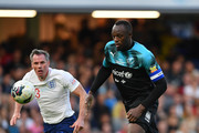 Usain Bolt of Soccer Aid World XI takes on Jamie Carragher of England during the Soccer Aid for UNICEF 2019 match between England and the Soccer Aid World XI at Stamford Bridge on June 16, 2019 in London, England.
