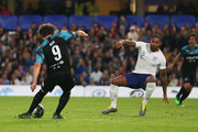 Kem Cetinay of Soccer Aid World XI (9) scores his team's second goal past Glen Johnson of England during the Soccer Aid for UNICEF 2019 match between England and the Soccer Aid World XI at Stamford Bridge on June 16, 2019 in London, England.