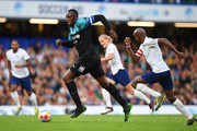 Usain Bolt of Soccer Aid World XI is chased by Sir Mo Farah of England during the Soccer Aid for UNICEF 2019 match between England and the Soccer Aid World XI at Stamford Bridge on June 16, 2019 in London, England.