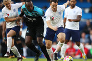 Sam Claflin and Katie Chapman of England battle with Usain Bolt of Soccer Aid World XI during the Soccer Aid for UNICEF 2019 match between England and the Soccer Aid World XI at Stamford Bridge on June 16, 2019 in London, England.