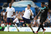 Sam Claflin of England evades Locksmith of Soccer Aid World XI during the Soccer Aid for UNICEF 2019 match between England and the Soccer Aid World XI at Stamford Bridge on June 16, 2019 in London, England.