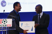 The first-ever FIFA Diversity Award is presented to India for 'Slum Soccer' by Clarence Seedorf, former Netherlands International during day 1 of the Soccerex Global Convention 2016 at Manchester Central Convention Complex on September 26, 2016 in Manchester, England.