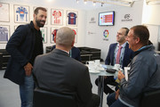Ruud van Nistelrooy (L) of the Netherlands talks to guests during day 1 of the Soccerex Global Convention at Manchester Central Convention Complex on September 4, 2017 in Manchester, England.