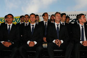 Members of the Socceroos including Tim Cahill, captain Lucas Neill, coach Pim Verbeek and Harry Kewell in the front row look on during the Australian Socceroos farewell function at Tullamarine Airport on May 26, 2010 in Melbourne, Australia.