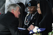 Secretary of the Army, John McHugh (L), comforts Lisa Laidley following the burial service for her son, U.S. Army Sergeant First Class Ramon Morris, at Arlington National Cemetery January 23, 2015 in Arlington, Virginia. Morris died while serving in Afghanistan on December 12, 2014 from injuries caused by an improvised explosive device. Also pictured is Laidley's her other son, U.S. Army Sergeant First Class Marlon Laidley (C).