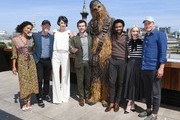 Thandie Newton, Ron Howard, Phoebe Waller-Bridge, Alden Ehrenreich, Chewbacca, Donald Glover, Emilia Clarke and Woody Harrelson attend Solo: A Star Wars Story photocall on May 18, 2018 in London, United Kingdom.