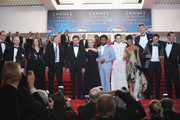 """Actor Paul Bettany, director Ron Howard, producer Kathleen Kennedy, actors Woody Harrelson, Alden Ehrenreich, Emilia Clarke, Donald Glover, Phoebe Waller-Bridge, Thandie Newton, Joonas Suotamo, screenwriter Jonathan Kasdan and producer Simon Emanuel  depart the screening of """"Solo: A Star Wars Story"""" during the 71st annual Cannes Film Festival at Palais des Festivals on May 15, 2018 in Cannes, France."""