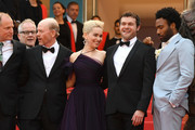 """(L-R) Woody Harrelson, Cannes Film Festival Director Thierry Fremaux,  Ron Howard, Emilia Clarke, Alden Ehrenreich and Donald Glove attends the screening of """"Solo: A Star Wars Story"""" during the 71st annual Cannes Film Festival at Palais des Festivals on May 15, 2018 in Cannes, France."""