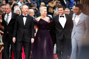 """Actor Woody Harrelson, director Ron Howard, actress Emilia Clarke, actors Alden Ehrenreich and Donald Glover attend the screening of """"Solo: A Star Wars Story"""" during the 71st annual Cannes Film Festival at Palais des Festivals on May 15, 2018 in Cannes, France."""