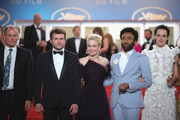 """Actors Woody Harrelson, Alden Ehrenreich, Emilia Clarke, Donald Glover and Phoebe Waller-Bridge depart the screening of """"Solo: A Star Wars Story"""" during the 71st annual Cannes Film Festival at Palais des Festivals on May 15, 2018 in Cannes, France."""