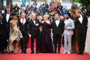 """Joonas Suotamo, Thandie Newton, Woody Harrelson, Ron Howard, Emilia Clarke, Alden Ehrenreich, Donald Glover, Chewbacca and Paul Bettany attend the screening of """"Solo: A Star Wars Story"""" during the 71st annual Cannes Film Festival at Palais des Festivals on May 15, 2018 in Cannes, France."""