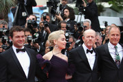 """(L-R) Alden Ehrenreich, Emilia Clarke, director Ron Howard and Woody Harrelson attend the screening of """"Solo: A Star Wars Story"""" during the 71st annual Cannes Film Festival at Palais des Festivals on May 15, 2018 in Cannes, France."""