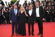 """Clovis Cornillac, Andrea Bescond, Eric Metayer and François Kraus of Little Tickles (Les Chatouilles) attend the screening of """"Solo: A Star Wars Story"""" during the 71st annual Cannes Film Festival at Palais des Festivals on May 15, 2018 in Cannes, France."""