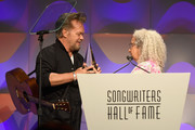 Songwriters Hall of Fame Inductee John Mellencamp accepts an award from Nora Guthrie onstage during the Songwriters Hall of Fame 49th Annual Induction and Awards Dinner at New York Marriott Marquis Hotel on June 14, 2018 in New York City.