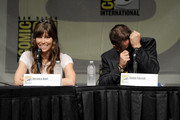 """Actors Jessica Biel (L) and Colin Farrell speak during Sony's """"Total Recall"""" panel during Comic-Con International 2012 at San Diego Convention Center on July 13, 2012 in San Diego, California."""