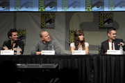 """(L-R) Director Len Wiseman, actors Bryan Cranston, Jessica Biel, and Colin Farrell speak during Sony's """"Total Recall"""" panel during Comic-Con International 2012 at San Diego Convention Center on July 13, 2012 in San Diego, California."""