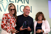 Ferzan Ozpetek receives his award with Nina Zilli (L) and Laura Delli Colli at the Soundtrack Awards during the 76th Venice Film Festival at Excelsior Hotel on September 04, 2019 in Venice, Italy.