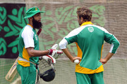 Hashim Amla (L) and Imran Tahir of South Africa chat during a South Africa nets session at SBNCS Stadium on March 24, 2011 in Dhaka, Bangladesh.