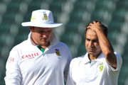 Graeme Smith of South Africa gives advice to Imran Tahir during day five of the 2nd Test match between South Africa and Australia, at Wanderers on November 21, 2011 in Johannesburg, South Africa.