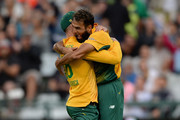 Imran Tahir of South Africa celebrates with captain Faf du Plessis after dismissing Moeen Ali of England during the 1st KFC T20 International match between South Africa and England at Newlands on February 19, 2016 in Cape Town, South Africa.
