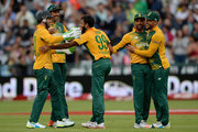 Imran Tahir of South Africa celebrates with teammates after dismissing Moeen Ali of England during the 1st KFC T20 International match between South Africa and England at Newlands on February 19, 2016 in Cape Town, South Africa.