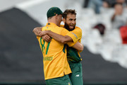 Imran Tahir of South Africa celebrates with Kyle Abbott of South Africa after dismissing England captain Eoin Morgan during the 1st KFC T20 International match between South Africa and England at Newlands on February 19, 2016 in Cape Town, South Africa.