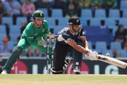 Grant Elliott of New Zealand sweeps with Mark Boucher of South Africa looking on during the ICC Champions Trophy Group B match between South Africa and New Zealand on September 24, 2009 in Centurion, South Africa.