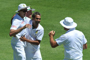 Imran Tahir and Morne Morkel of South Africa celebrate the wicket of Thisara Perera of Sri Lanka during day 4 of the 3rd Sunfoil Test match between South Africa and Sri Lanka at Sahara Park Newlands on January 06, 2012 in Cape Town, South Africa.