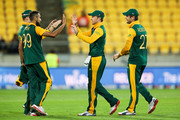 L to R, Imran Tahir, AB de Villiers and Rilee Rossouw of South Africa celebrate the wicket of Shaiman Anwar of the United Arab Emirates during the 2015 ICC Cricket World Cup match between South Africa and the United Arab Emirates at Wellington Regional Stadium on March 12, 2015 in Wellington, New Zealand.
