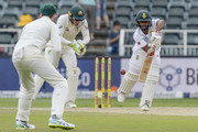 Temba Bavuma of South Africa and Captain Tim Paine of Australia during day 2 of the 4th Sunfoil Test match between South Africa and Australia at Bidvest Wanderers Stadium on March 31, 2018 in Johannesburg, South Africa.