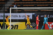 Wang Shanshan (2nd L) of China celebrates scoring the opening goal with her team mate Tang Jiali (1st L) during the EAFF E-1 Women's Football Championship between South Korea and China at Fukuda Denshi Arena on December 15, 2017 in Chiba, Japan.