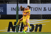 Wang Shanshan (R) of China celebrates scoring the opening goal with her team mate Tang Jiali (L) during the EAFF E-1 Women's Football Championship between South Korea and China at Fukuda Denshi Arena on December 15, 2017 in Chiba, Japan.